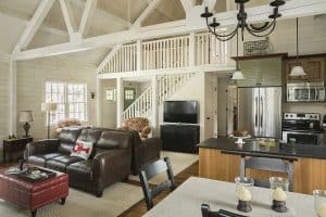 Arborwall Solid Cedar Homes feature soaring log truss ceilings with shiplap style wall finishes
