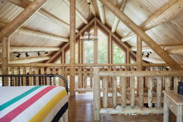 Open wooden loft area with beds
