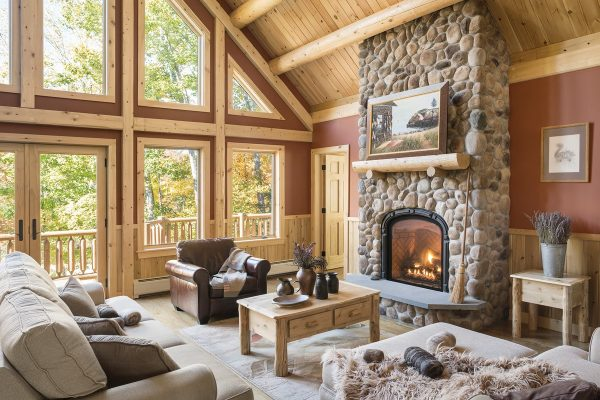 Living room with vaulted ceilings and a stone fireplace