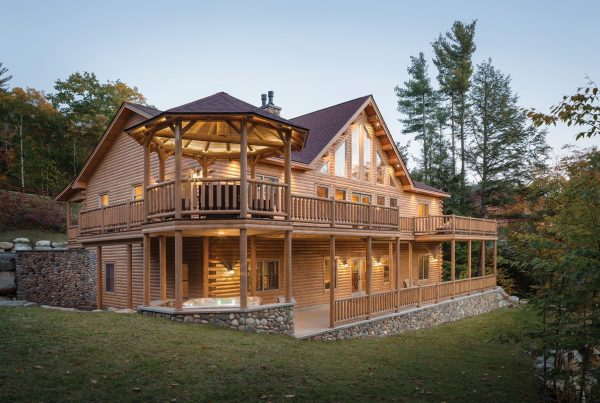 Exterior multi level with a wrap around deck custom log home