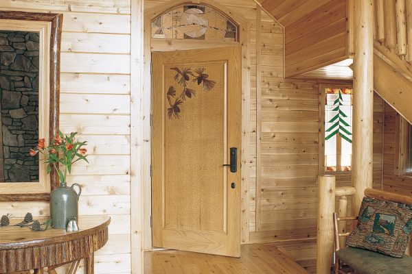 Entrance to master bedroom with decorative wooden door