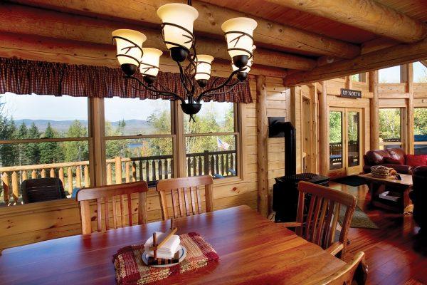Custom log home owned by Tom Carpenter at 62 Mooseridge Road, Rangeley, ME