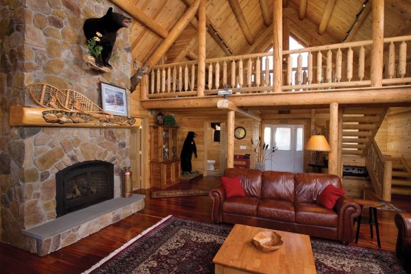 Custom log home owned by Tom Carpenter at 62 Mooseridge Road, Rangeley, ME