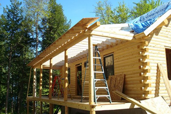 Construction of the porch on a log home from Big Twig.