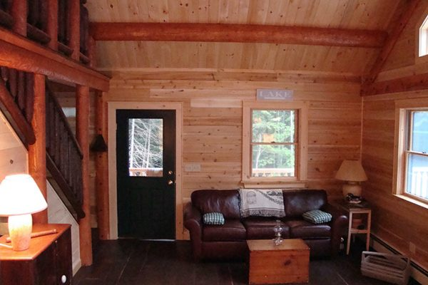The living room in a cozy log cabin from Big Twig Homes.