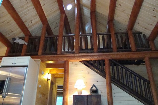 A view of the loft in this log cabin home.