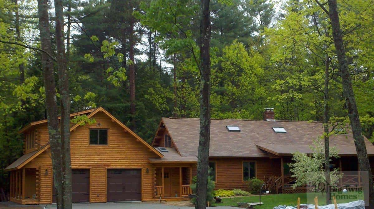 A view of the garage on a log home.