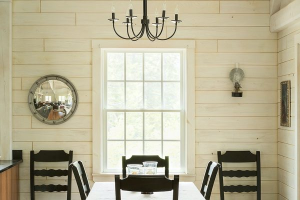 A modest chandelier over a dining table.