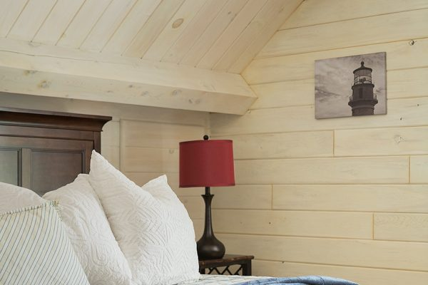 Exposed wood beams give this bedroom a cozy feel.