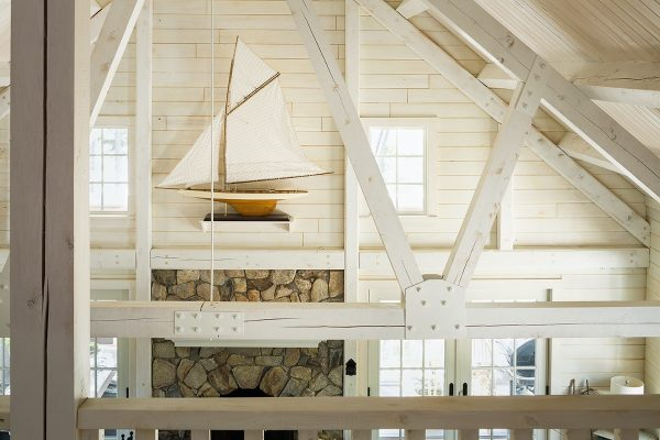 A vaulted ceiling with painted wooden timbers.