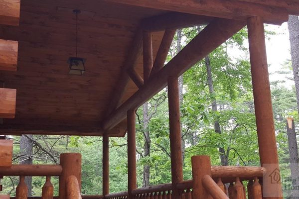 The view from the front porch of a log home.