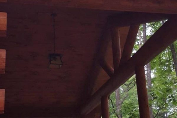 Details of the front porch on a log home.