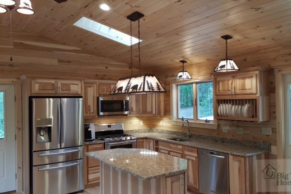Beautiful lighting in a custom kitchen from Big Twig homes.
