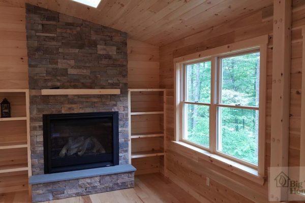 A custom fireplace in a log home.