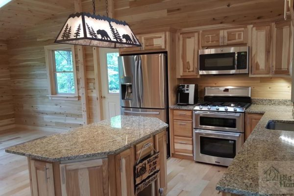 A beautiful custom kitchen in a log home built by Big Twig Homes.