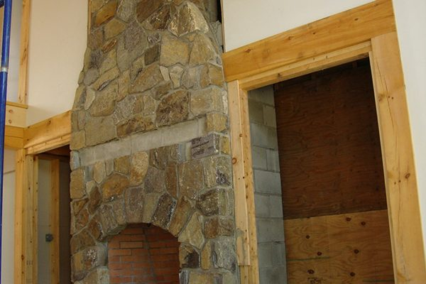A handcrafted stone fireplace.