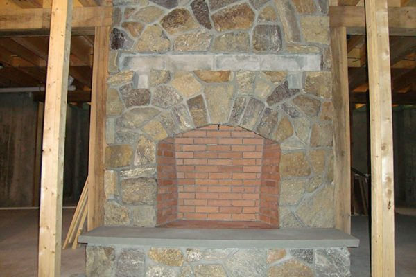 A beautiful stone fireplace in a home built by Big Twig Homes.