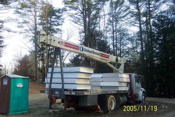 Structurally insulated panels being delivered by a truck.