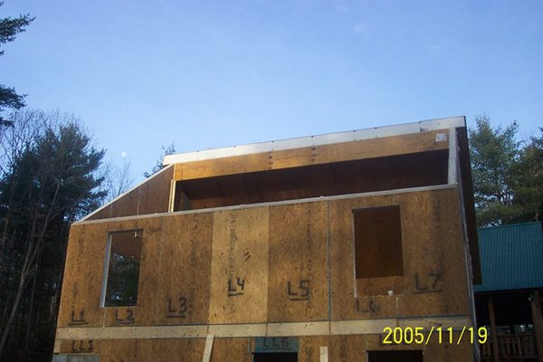 The walls and roof being constructed with structurally insulated panels.
