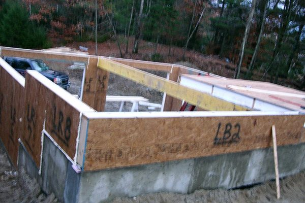 The backside of the garage foundation being constructed.