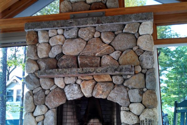 closeup of outdoor fireplace in sunroom