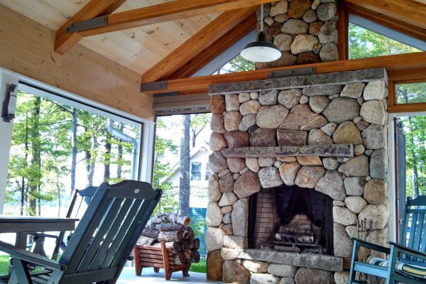 outdoor fireplace in sunroom