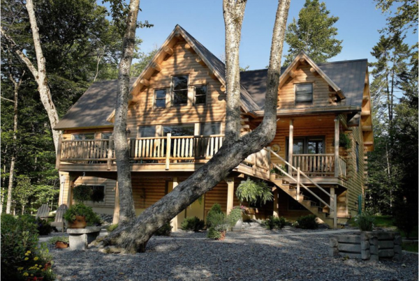 exterior view of log home from driveway
