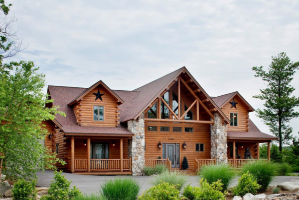 Log home with landscaping